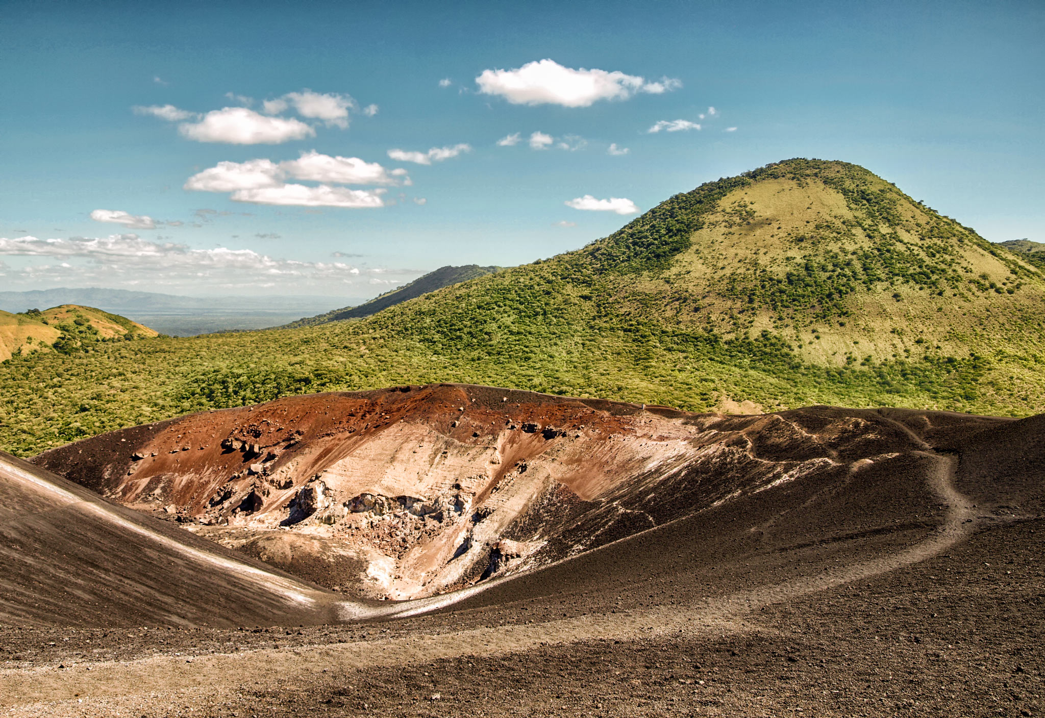 The contrast between the volcano and its green surroundings were like night and day.