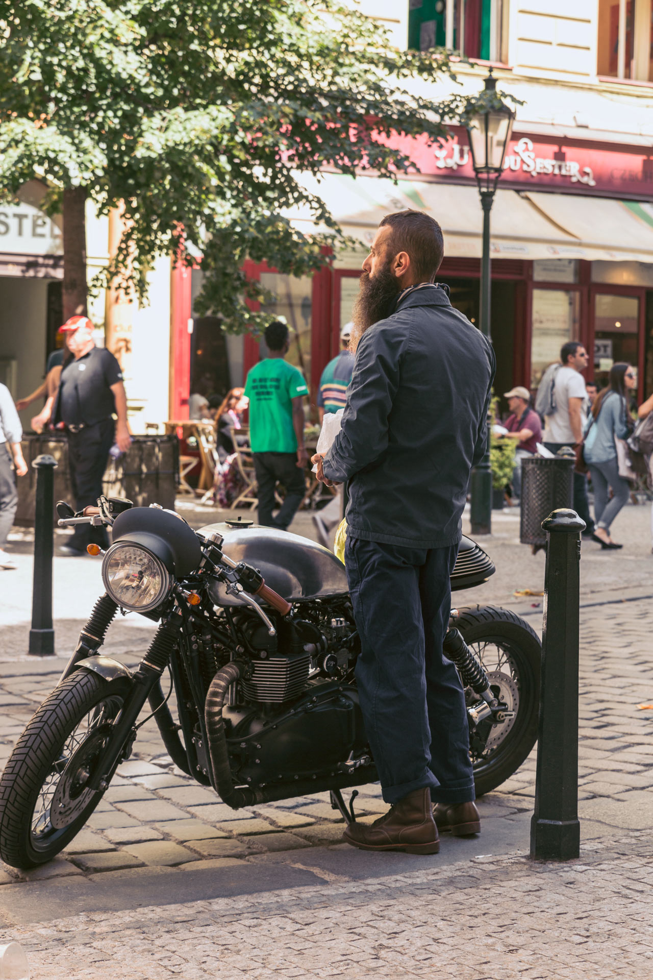 A classy man and his bike, paparazzi style.