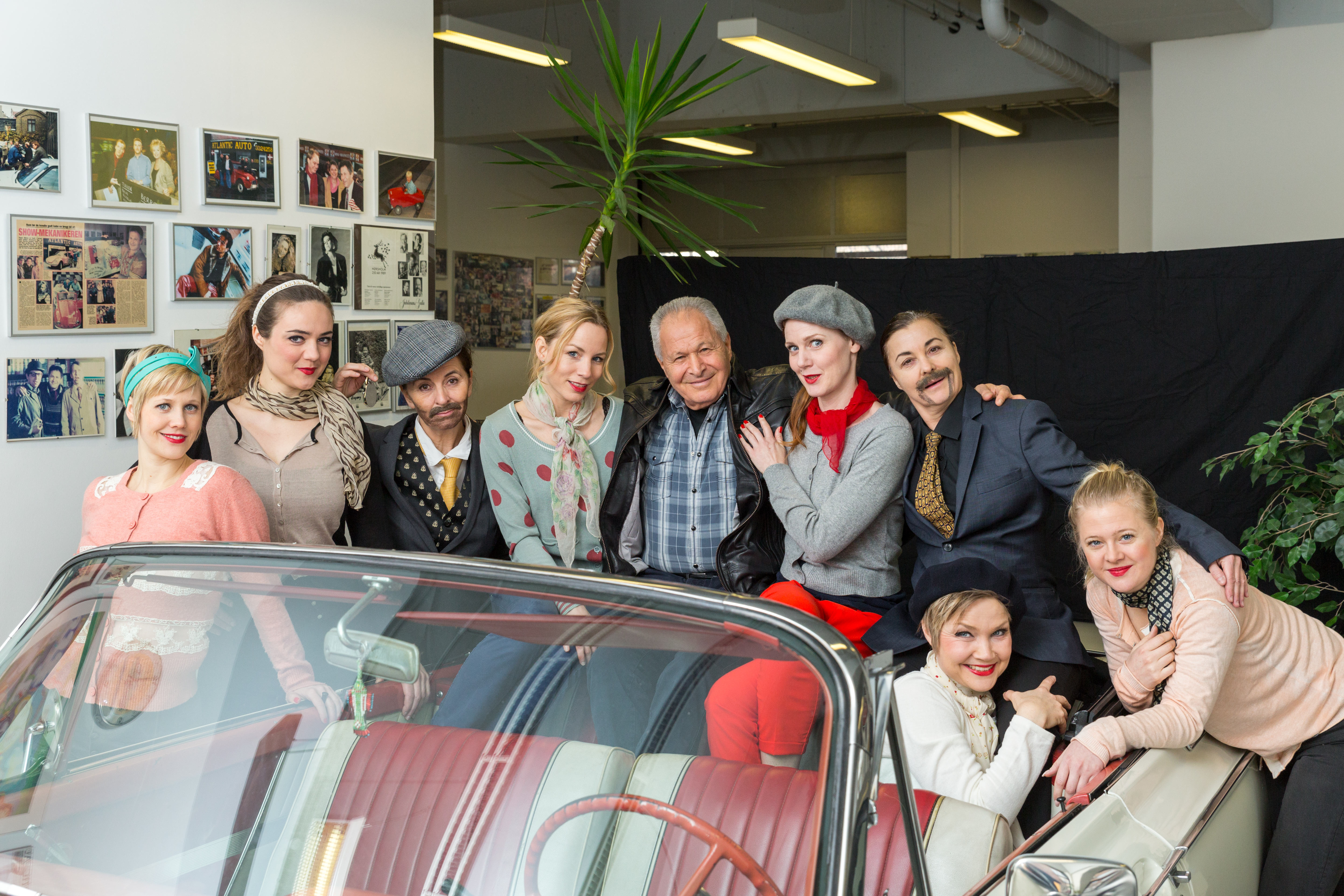 The man on the set: Meier. It is his beautiful vintage car. What could be better than 8 girls sitting in it?